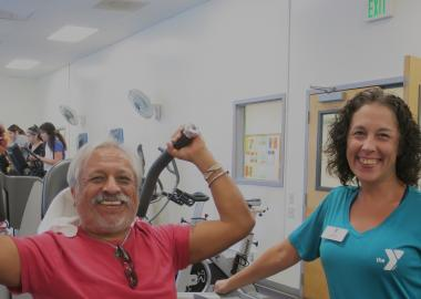 Wellness Coach Karen Biddle at Sequoia YMCA with a Y member