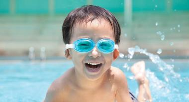 Youth enjoys swimming outdoors